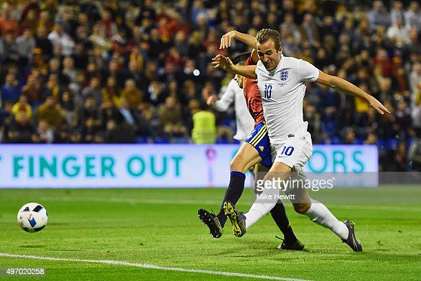 Harry Kane of England battles with Marc Bartra of Spain during the international friendly match between Spain and England at Jose Rico Perez Stadium...