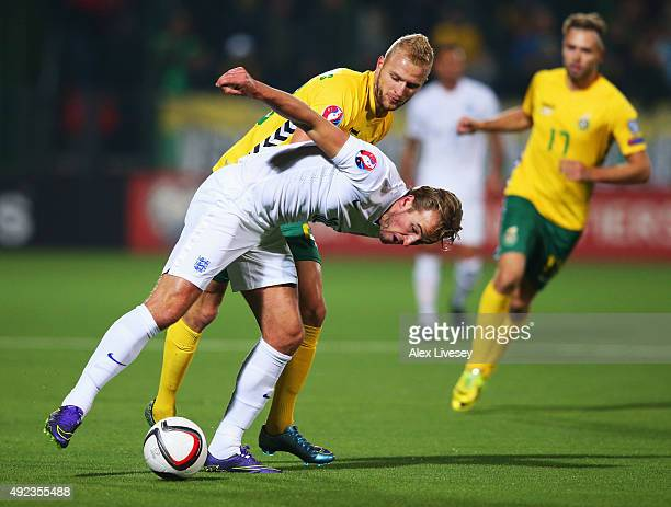Harry Kane of England battles with Vytautas Andriukevicius of Lithuania during the UEFA EURO 2016 qualifying Group E match between Lithuania and...