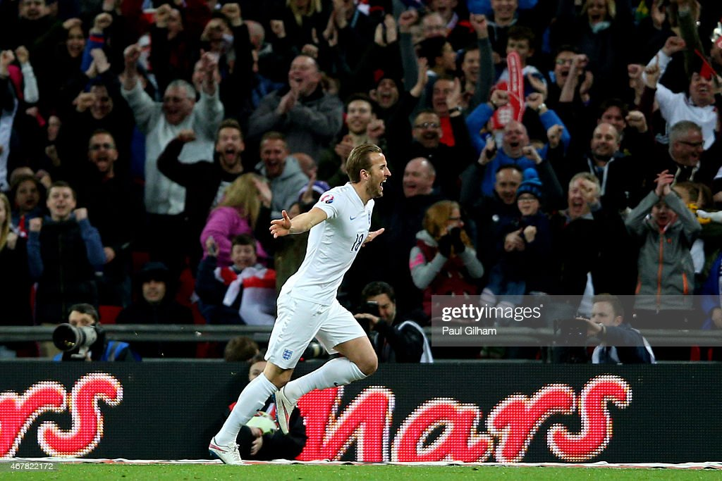 Harry Kane of England celebrates after scoring on his debut during the EURO 2016 Qualifier match between England and Lithuania at Wembley Stadium on...