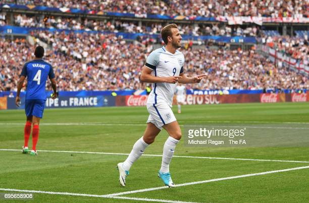 Harry Kane of England celebrates as he scores their first goal during the International Friendly match between France and England at Stade de France...