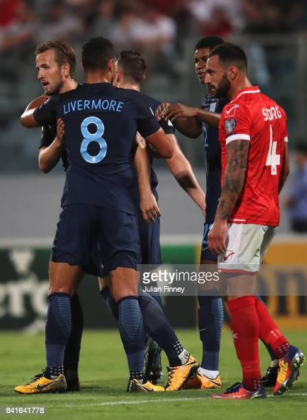 Harry Kane of England celebrates as he scores their first goal with Jake Livermore during the FIFA 2018 World Cup Qualifier between Malta and England...