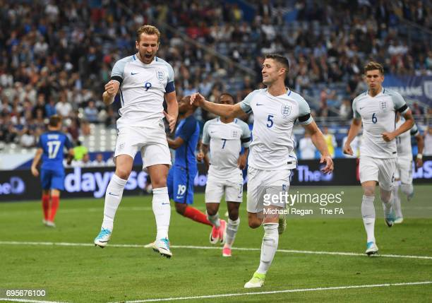 Harry Kane of England celebrates as he scores their second goal from a penalty during the International Friendly match between France and England at...