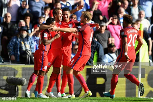 Harry Kane of England celebrates scoring his sides second goal with his team mates during the FIFA 2018 World Cup Qualifier between Scotland and...