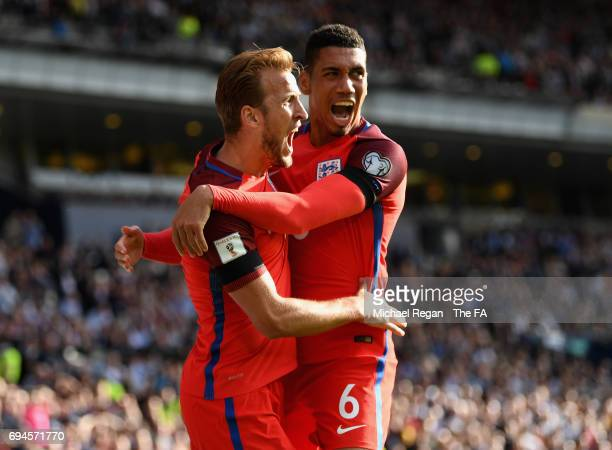 Harry Kane of England celebrates scoring his sides second goal with Chris Smalling of England during the FIFA 2018 World Cup Qualifier between...