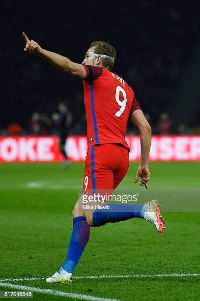 Harry Kane of England celebrates scoring his team's first goal during the International Friendly match between Germany and England at Olympiastadion...