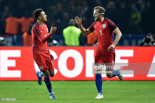 Harry Kane of England celebrates scoring his team's first goal with his team mate Dele Alli during the International Friendly match between Germany...