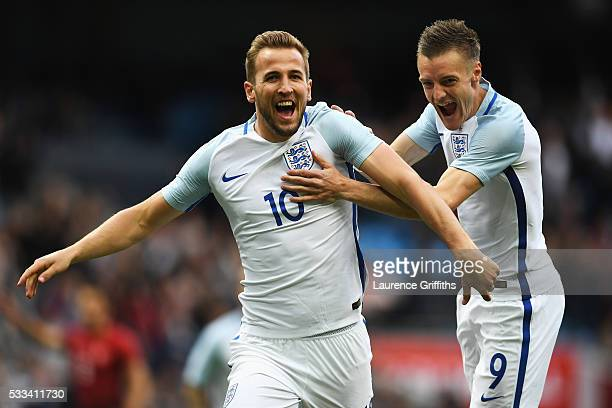 Harry Kane of England celebrates with Jamie Vardy of England after he scored the opening goal during the International Friendly match between England...