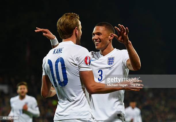 Harry Kane of England celebrates with Kieran Gibbs of England as his shot rebounds off goalkeeper Giedrius Arlauskis of Lithuania for an own goal and...