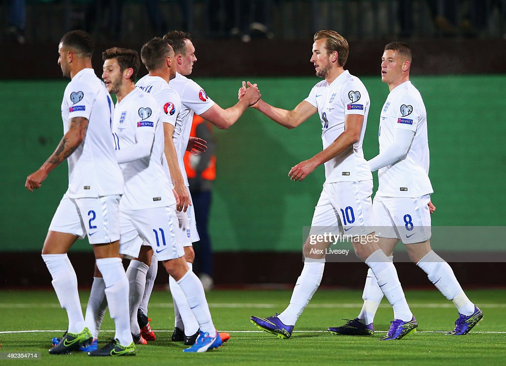 Harry Kane of England celebrates with Phil Jones as his shot rebounds off goalkeeper Giedrius Arlauskis of Lithuania for an own goal and England's...