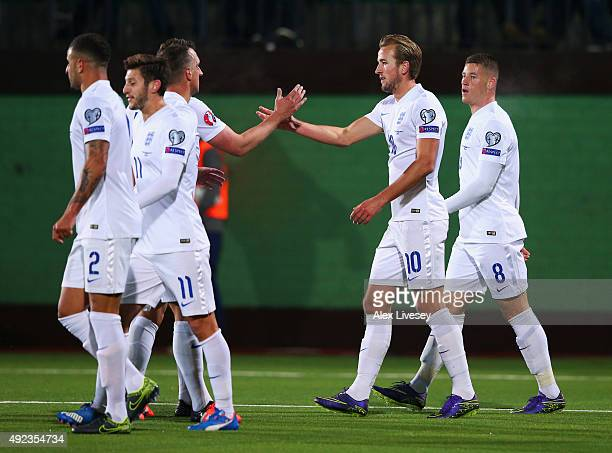 Harry Kane of England celebrates with team mates as his shot rebounds off goalkeeper Giedrius Arlauskis of Lithuania for an own goal and England's...
