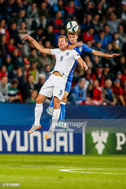 Harry Kane of England competes for the ball in the air with Daniele Rugani of Italy during the UEFA Under21 European Championship 2015 match between...