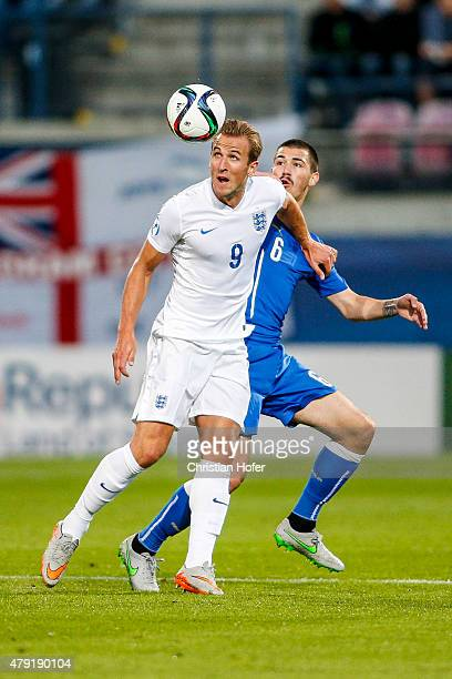 Harry Kane of England competes for the ball with Alessio Romagnoli of Italy during the UEFA Under21 European Championship 2015 match between England...