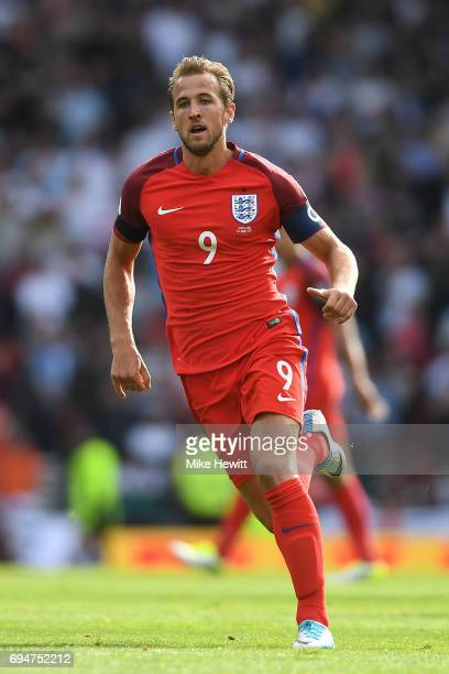 Harry Kane of England in action during the FIFA 2018 World Cup Qualifier between Scotland and England at Hampden Park National Stadium on June 10...