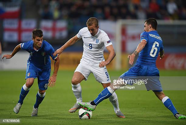 Harry Kane of England in action with Lorenzo Crisetig and Alessio Romagnoliof Italy during the UEFA Under21 European Championship match between...