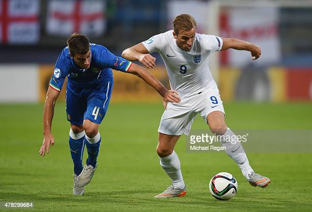 Harry Kane of England in action with Lorenzo Crisetig of Italy during the UEFA Under21 European Championship match between England and Italy at...