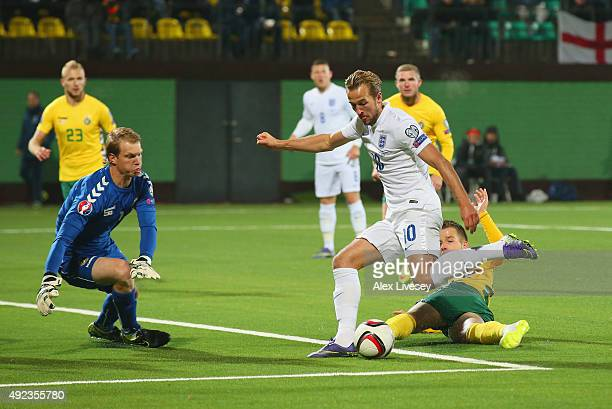 Harry Kane of England is faced by goalkeeper Giedrius Arlauskis of Lithuania during the UEFA EURO 2016 qualifying Group E match between Lithuania and...