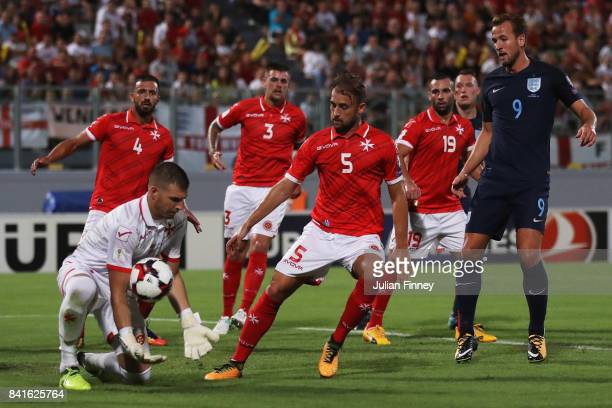 Harry Kane of England is outnumbered by the Malta defence as Andrew Hogg of Malta catches the ball during the FIFA 2018 World Cup Qualifier between...
