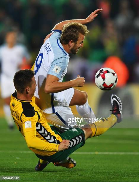 Harry Kane of England is tackled by Linas Klimavicius of Lithuania during the FIFA 2018 World Cup Group F Qualifier between Lithuania and England at...