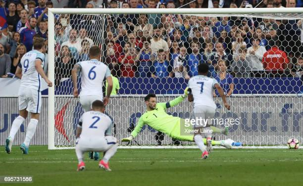 Harry Kane of England score a penalty shoot over Hugo LLoris of France during the International Friendly match between France and England at Stade de...