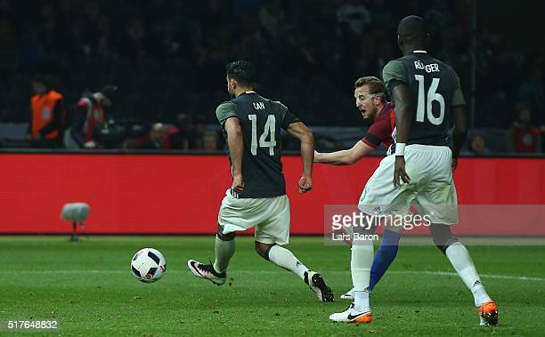 Harry Kane of England scores his teams first goal during the International Friendly match between Germany and England at Olympiastadion on March 26...