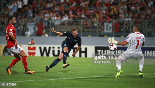 Harry Kane of England scores their fourth goal past Andrew Hogg of Malta during the FIFA 2018 World Cup Qualifier between Malta and England at...