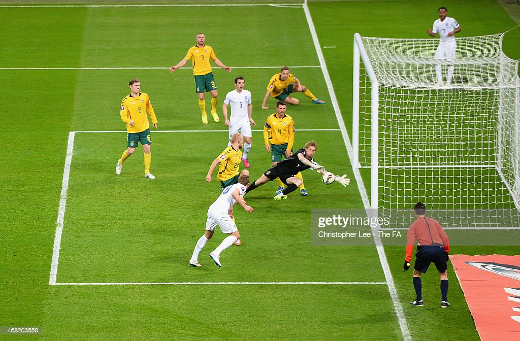 Harry Kane of England scores their fourth goal past Giedrius Arlauskis of Lithuania during the EURO 2016 Qualifier between England and Lithuania at...