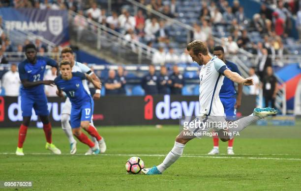 Harry Kane of England scores their second goal from a penalty during the International Friendly match between France and England at Stade de France...