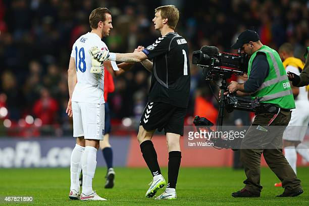 Harry Kane of England shakes the hands of Giedrius Arlauskis of Lithuania after the EURO 2016 Qualifier match between England and Lithuania at...