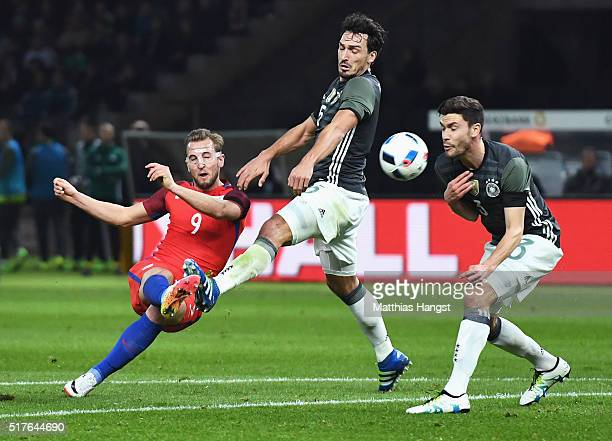Harry Kane of England shoots at goal while Mats Hummels and Jonas Hector of Germany try to block during the International Friendly match between...