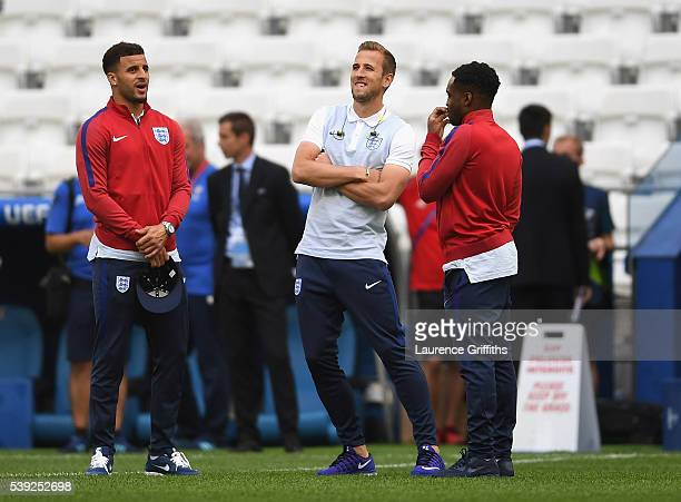 Harry Kane of England speaks with Kyle Walker and Danny Rose during an England training session ahead of the EURO 2016 Group B match against England...