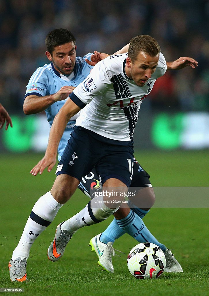 Harry Kane of Hotspur contests the ball with Peter Triantis of Sydney FC during the international friendly match between Sydney FC and Tottenham Spurs at ANZ Stadium on May 30, 2015 in Sydney, Australia.