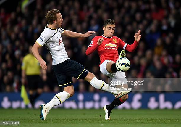 Harry Kane of Spurs and Andreas Pereira of Manchester United compete for the ball during the Barclays Premier League match between Manchester United...