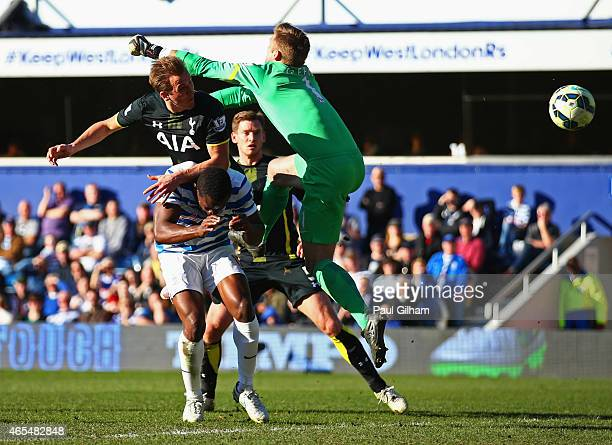 Harry Kane of Spurs beats Robert Green of QPR to score their first goal with a header during the Barclays Premier League match between Queens Park...