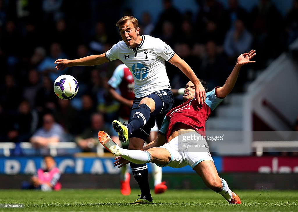 Harry Kane of Spurs is tackled by James Tomkins of West Ham during the Barclays Premier League match between West Ham United and Tottenham Hotspur at Boleyn Ground on May 3, 2014 in London, England.