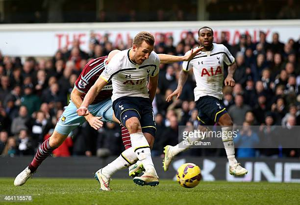Harry Kane of Spurs scores past goalkeeper Adrian of West Ham from the penalty rebound to level the scores at 22 during the Barclays Premier League...