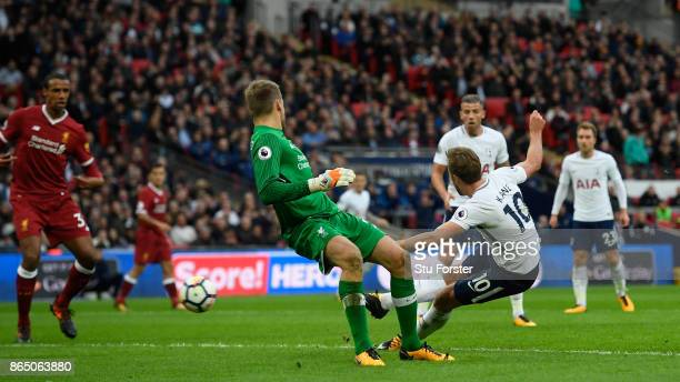 Harry Kane of Spurs scores the fourth goal and his second of the game past Simon Mignolet during the Premier League match between Tottenham Hotspur...
