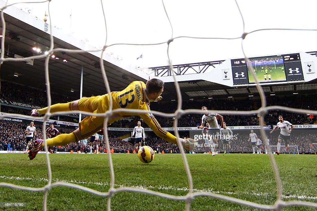 Harry Kane of Spurs takes an injury time penalty which is saved by goalkeeper Adrian of West Ham during the Barclays Premier League match between Tottenham Hotspur and West Ham United at White Hart Lane on February 22, 2015 in London, England. Harry Kane of Spurs scored levelled the scores at 2-2 by scoring from the rebound.