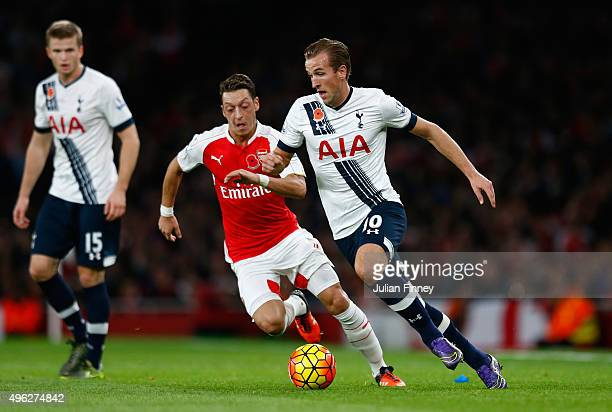 Harry Kane of Spurs takes on Mesut Oezil of Arsenal during the Barclays Premier League match between Arsenal and Tottenham Hotspur at the Emirates...