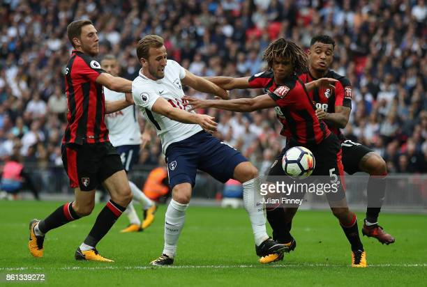 Harry Kane of Spurs tries to get a shot away under pressure by Nathan Ake of Bournemouth during the Premier League match between Tottenham Hotspur...