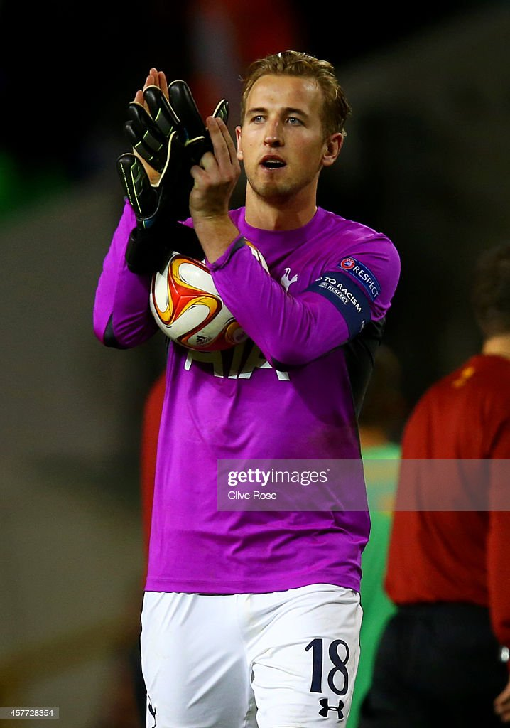 Harry Kane of Spurs, wearing the goalkeeper's shirt of team-mate Hugo Lloris, applauds the fans as holds the match ball following his hat-trick during the UEFA Europa League group C match between Tottenham Hotspur FC and Asteras Tripolis FC at White Hart Lane on October 23, 2014 in London, United Kingdom.