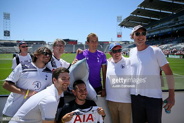 Harry Kane of the Tottenham Hotspur poses for a photo with fans following training ahead of a game against the MLS AllStar team at Dick's Sporting...