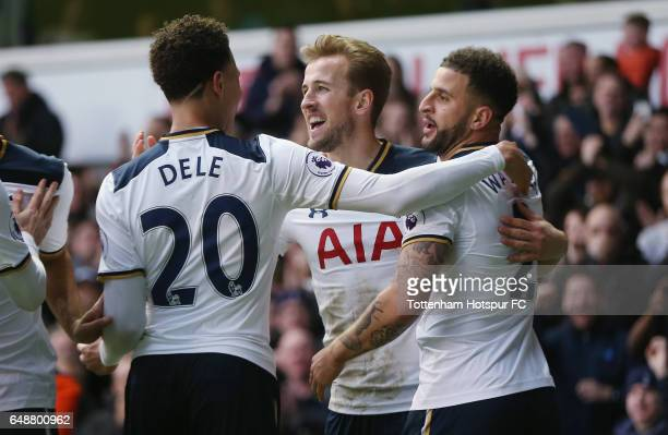 Harry Kane of Tottenham celebrates after scoring their second goal with Dele Alli and Kyle Walker during the Premier League match between Tottenham...