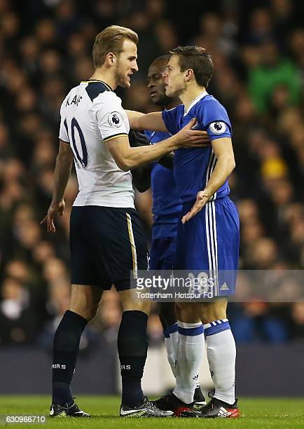 Harry Kane of Tottenham Hotspur and Cesar Azpilicueta of Chelsea confront each other during the Premier League match between Tottenham Hotspur and...