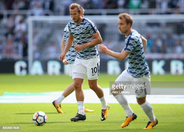 Harry Kane of Tottenham Hotspur and Christian Eriksen of Tottenham Hotspur warm up prior to the Premier League match between Newcastle United and...