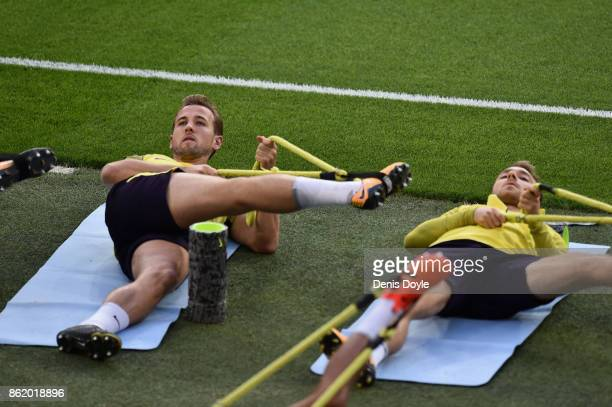 Harry Kane of Tottenham Hotspur and Christian Eriksen of Tottenham Hotspur stretch during a Tottenham Hotspur Training Session ahead of the Champions...