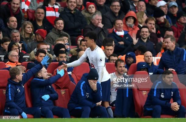 Harry Kane of Tottenham Hotspur and Dele Alli of Tottenham Hotspur are substituted during the Premier League match between Arsenal and Tottenham...