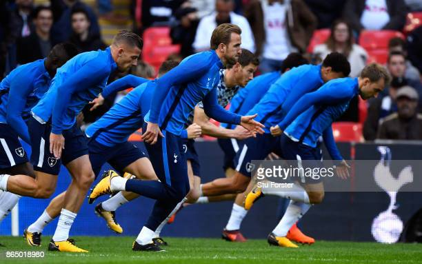 Harry Kane of Tottenham Hotspur and his Tottenham Hotspur team mates warm up prior to the Premier League match between Tottenham Hotspur and...