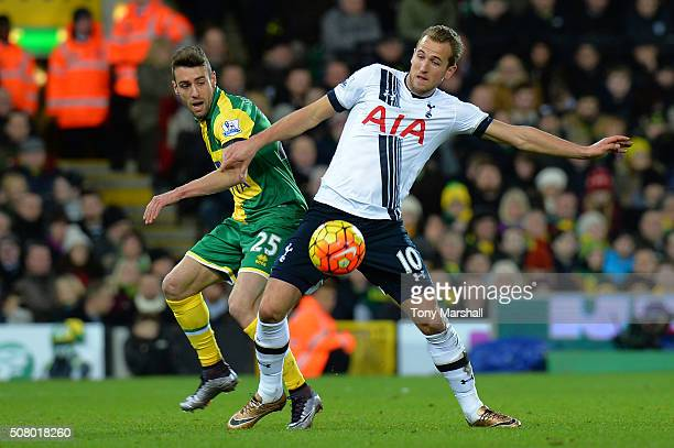 Harry Kane of Tottenham Hotspur and Ivo Pinto of Norwich City compete for the ball during the Barclays Premier League match between Norwich City and...
