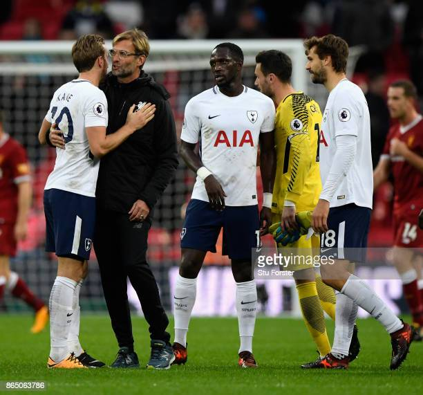 Harry Kane of Tottenham Hotspur and Jurgen Klopp Manager of Liverpool embrace after the Premier League match between Tottenham Hotspur and Liverpool...