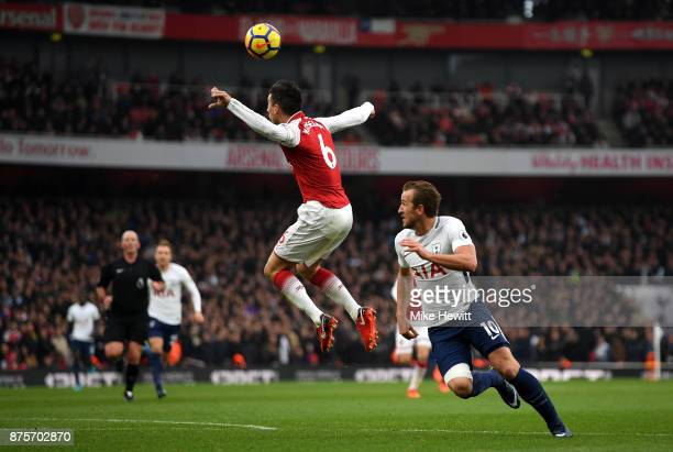 Harry Kane of Tottenham Hotspur and Laurent Koscielny of Arsenal in action during the Premier League match between Arsenal and Tottenham Hotspur at...